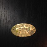 Brass plaques on back by Ivy Teddy